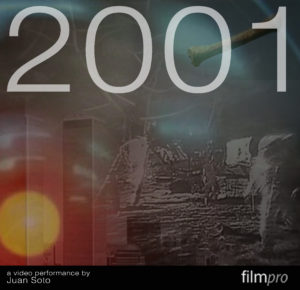 An indistinct picture of what appears to be a space landing with a bright red/yellow spot in the left hand corner as of a light or a sun. Across the top of the picture, '2001' is written in bold white lettering.